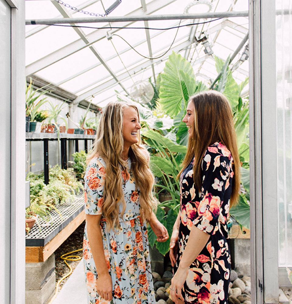 Two girls inside the BYU-Idaho Greenhouse