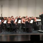 Mr. Hansen conducting his orchestra.