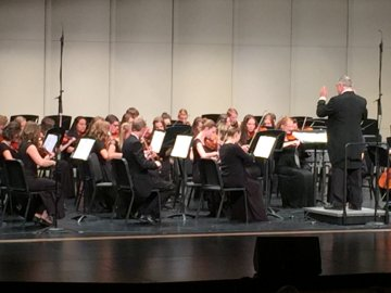 Mr. Hansen conducting his orchestra.