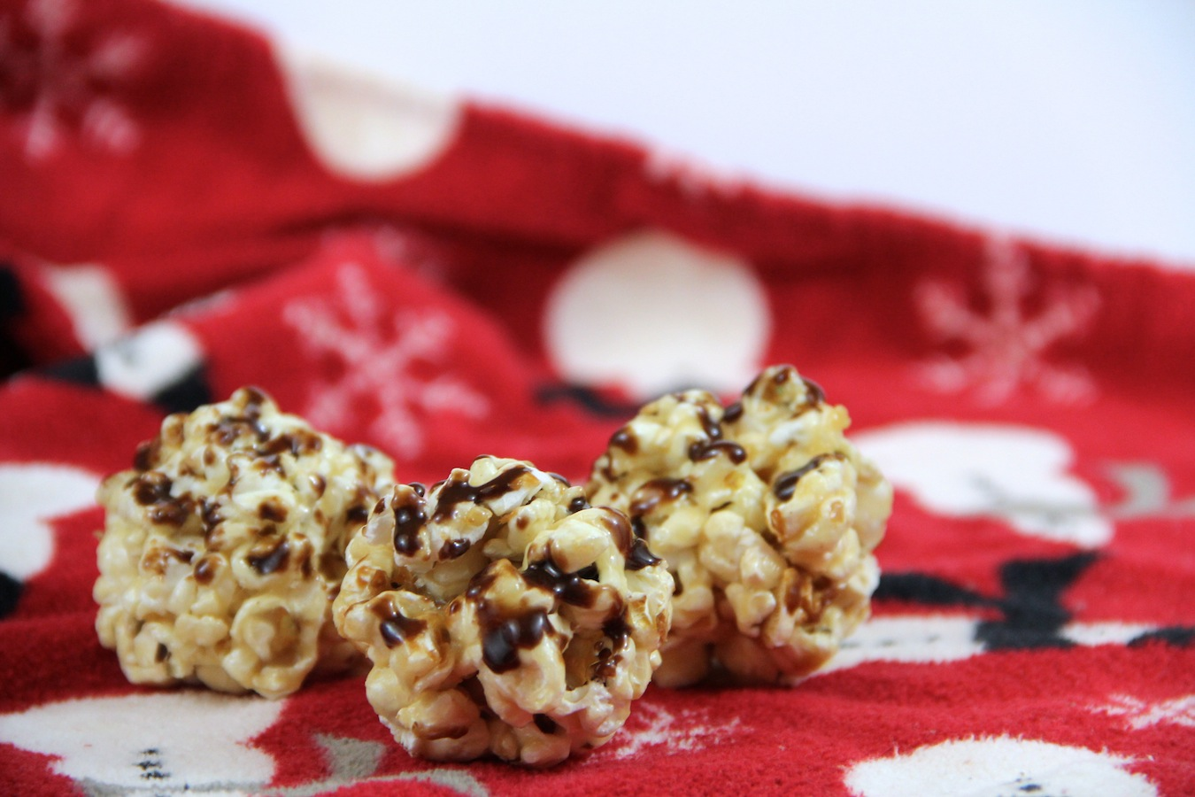 Peanut Butter and Nutella Popcorn Balls make for surprisingly healthy Christmas treats.