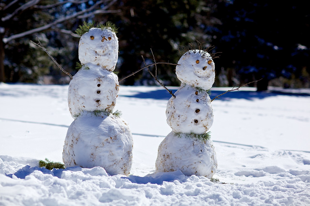 Building snowmen and women make for fun winter date ideas.