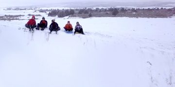 Sledding at the St. Anthony Sand Dunes is legit.