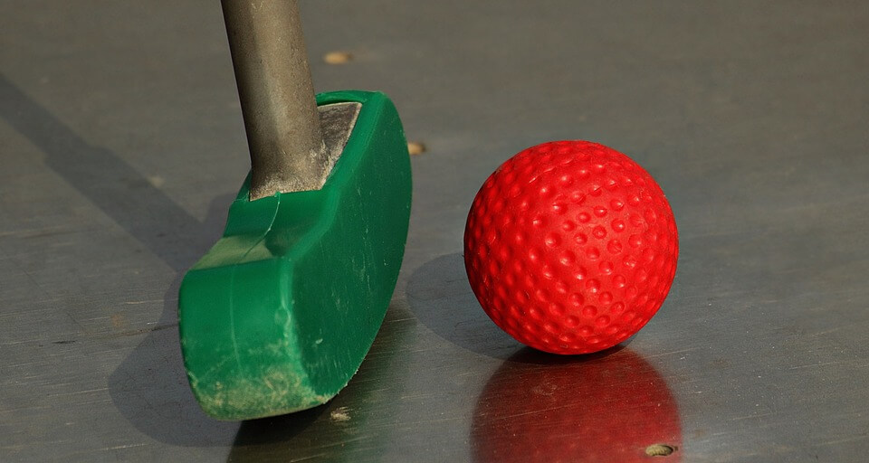 mini golf on campus is one of the good indoor date ideas