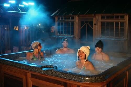 One of the good date ideas for Valentine's Day is to get cozy in a hot tub.