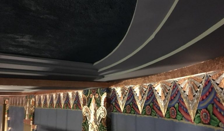 Community volunteers restore Romance Theater