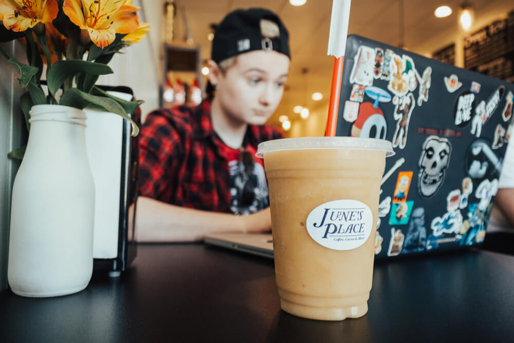 Student studying with drink at June's Place Grand Opening Rexburg