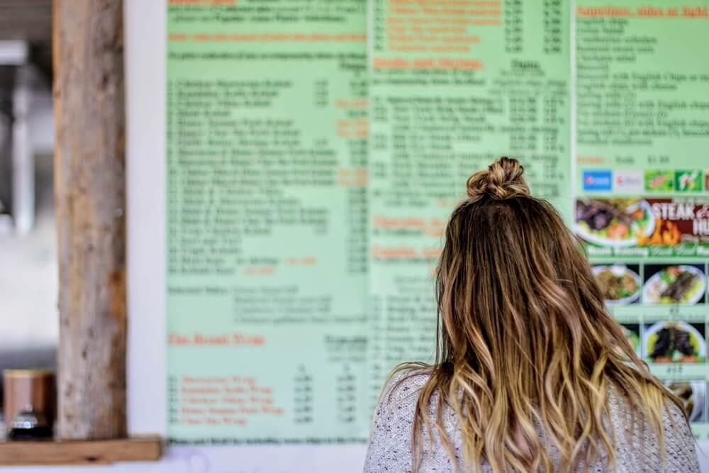 Girl looking at Steak and Kebab Hut menu