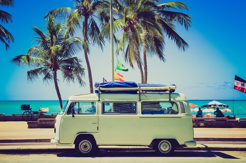 VW camper parked on the beach
