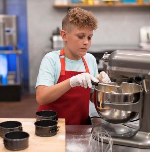 Keaton mixing on Kids Baking Championship