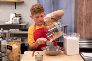 Keaton measuring on Kids Baking Championship